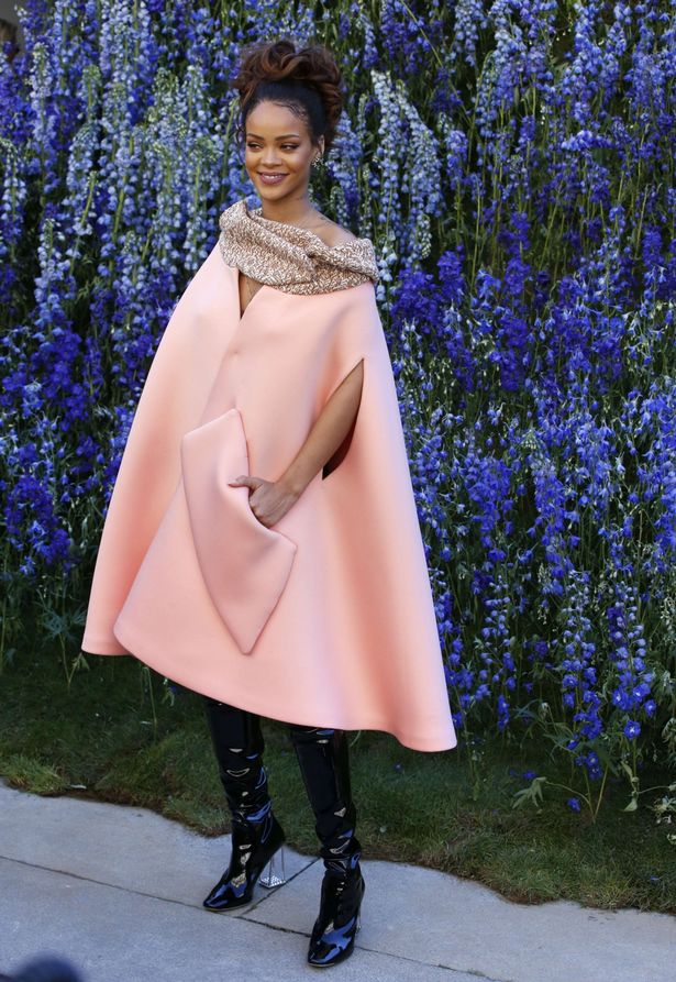 Barbadian-singer-Rihanna-poses-prior-to-the-start-of-the-Christian-Dior-2016
